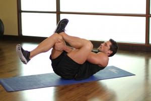 Растяжка ягодичных мышц в положении лежа, позиция 1